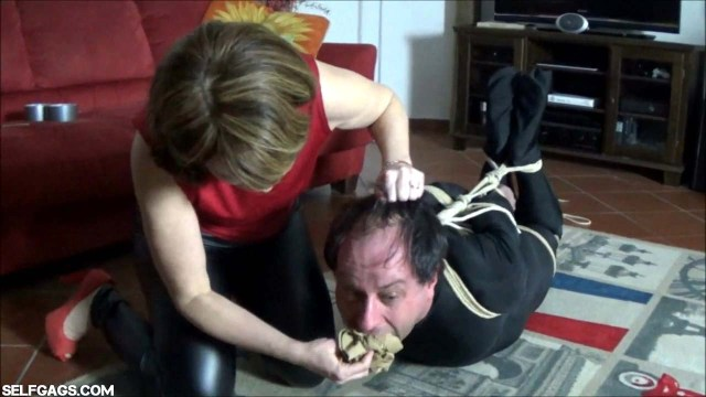 Hogtied man gagged with panties