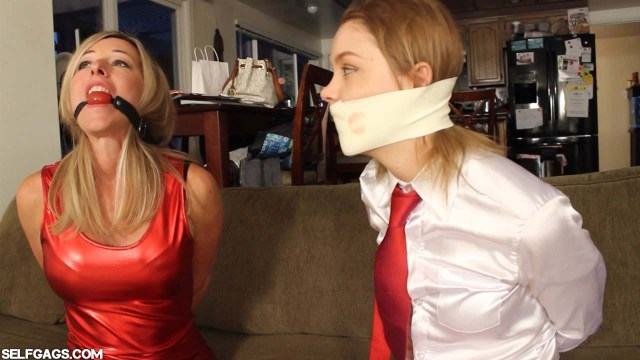 Ball gagged MILF tied up next to girl with microfoam tape on her mouth