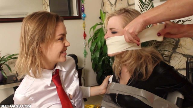Chairtied girl in bondage gagged tight with microfoam tape