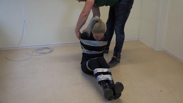 Female burglar in tape bondage