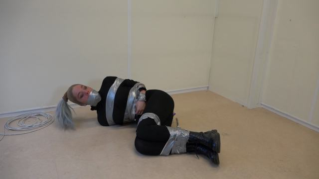 Luna Grey taped up and gagged