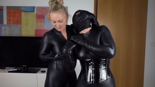Handgagged by girl in catsuit