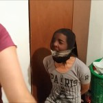 latina girl pantyhose head encased and cleave gagged with tape