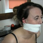 Fetish girl Carleyelle gagged with white duct tape and screaming