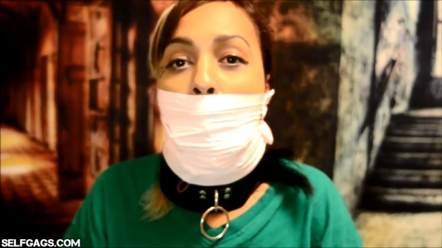 collared girl gagged with tape wrapped over her mouth