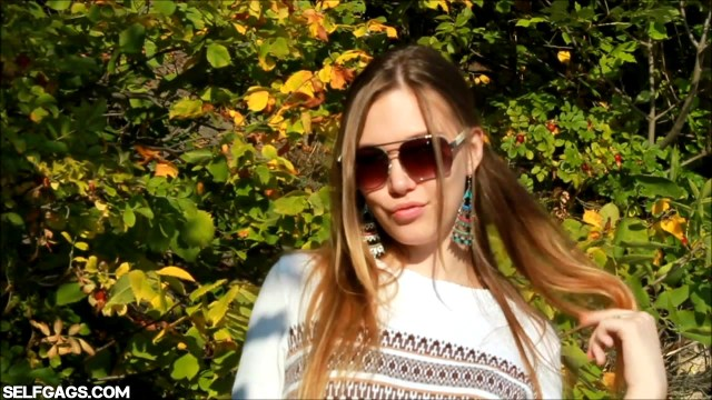 Sexy glamour model wearing sunglasses in the great outdoors