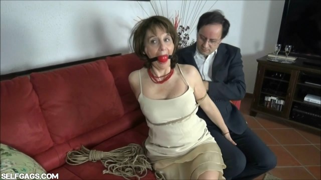 Cheating wife bound and ball gagged by lover