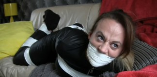 Sexy catsuit burglar Carleyelle tape bound and gagged on sofa