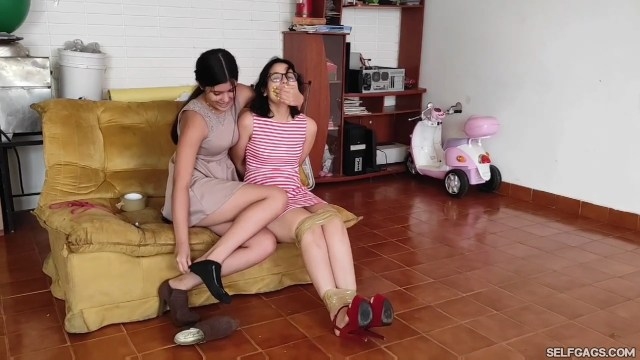 Nerdy girl bound and hand gagged by sexy girl
