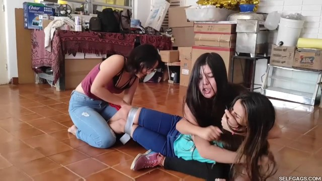 Sexy girl handgagged and wrestled into tape bondage by best friends