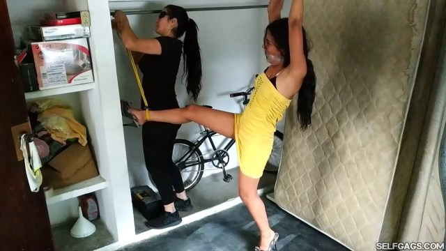 Young party girl kidnapped and gagged in tight predicament bondage