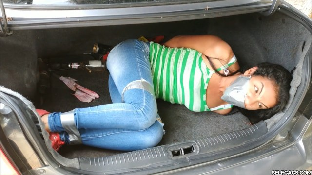 Young latina hitchhiker in jeans gagged for tape bondage in car trunk