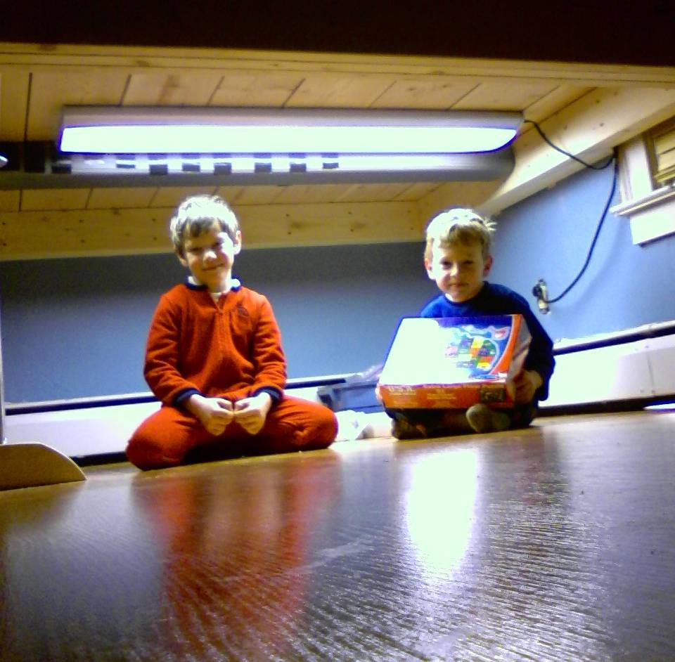 Two happy boys in their new play area, under my office.