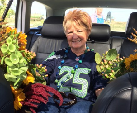 Patti Olds taking flowers from the farm to the center