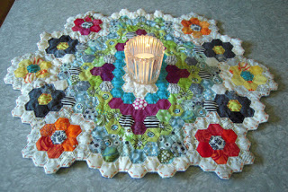 finished hexie placemat with lit candle