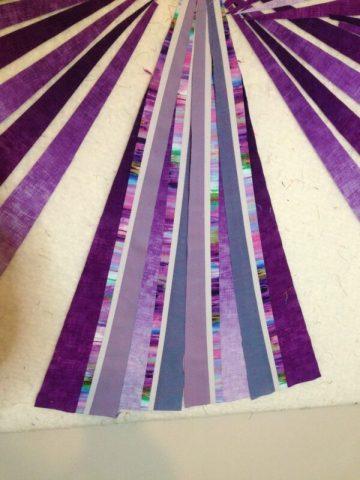 Purple fabric on design wall