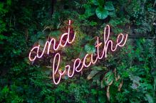 """""""and breathe"""" neon sign."""