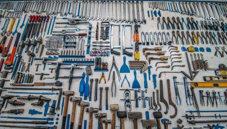Tools of all kind on a peg board to depict pain management tools.