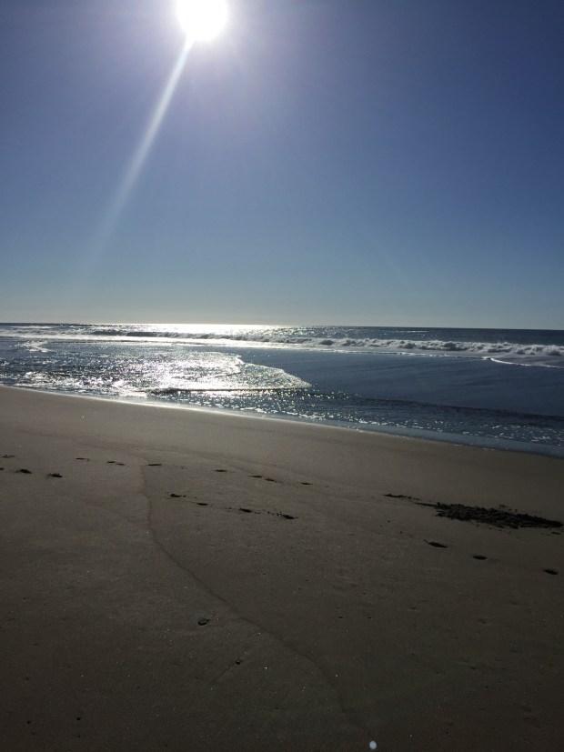 The sun shining on the ocean to reflect healing.
