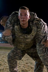 U_S__Army_Spc__Tyler_Green,_an_information_management_officer_for_the_human_resources_section,_with_U_S__Army_Central_performs_a_squat_while_carrying_another_