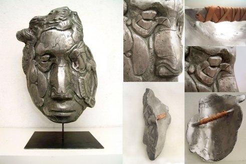 """"""" scudo per visionari """" - 2009, cm 52x40x25, aluminium cast and leather"""