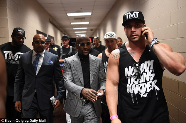 Mayweather with his bodyguards