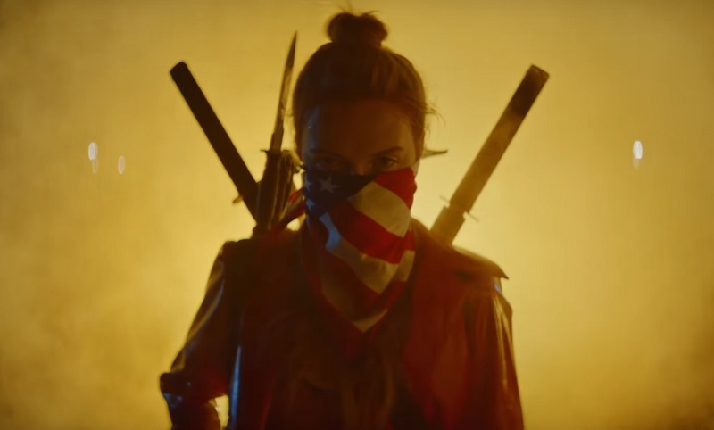Lilly with weapons in Assassination Nation
