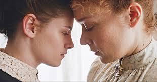 Lizzie and Bridget nearly kiss