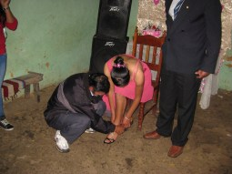 First step, after walking in with the Padrino (or god-father) is the real father puts on the high heels.