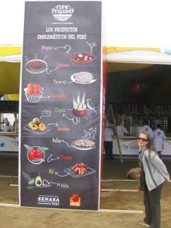 Andrea with a chart of many of the Peruvian cuisine elements. If you eat Peruvian food, you'll be eating alot of these things.