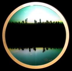Mayte Espinosa, First sun No. 1 , 2014, fotografía sobre espejo con marco de madera, 88 cm de diámetro