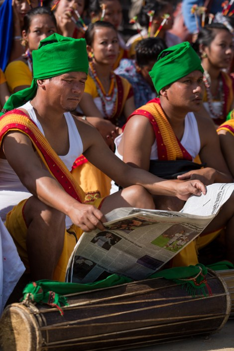 Members of Dimasa cultural troupe (Dimapur) waiting to perform at Hornbill Festival 2015, Kisama Village, Kohima District, Nagaland, India. Naga heritage is celebrated during colourful festivals: Hornbill is the Nagaland state government's ten-day festival organised every December, when Naga tribes converge wearing their traditional costumes and finery for tourists.