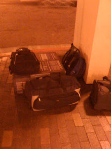 Our luggage under street lights outside the Metro Station in San Diego, CA. See The Box