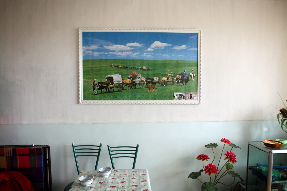 A painting of traditional Inner Mongolian life hangs in the living room of farmers on the Inner Mongolian steppes. This traditional life disappeared in the 1980s.