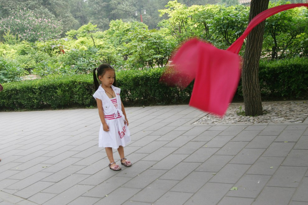 A young girl in Jinshan Park, located north of the Forbidden City.