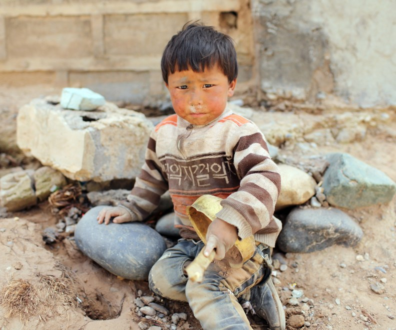 A young Tibetan boy in a relocation village in the Amdo region of the Tibetan Plateau.