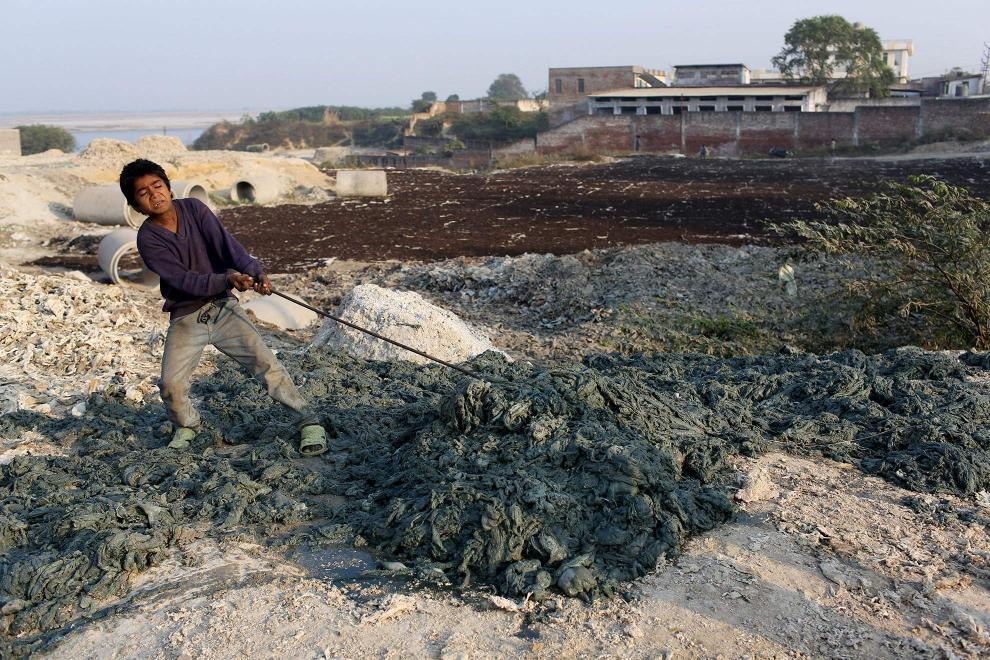 A child worker pulls discarded leather trimmings discarded from local tanneries. The waste is laced with toxic chemicals produced in the tanning process.