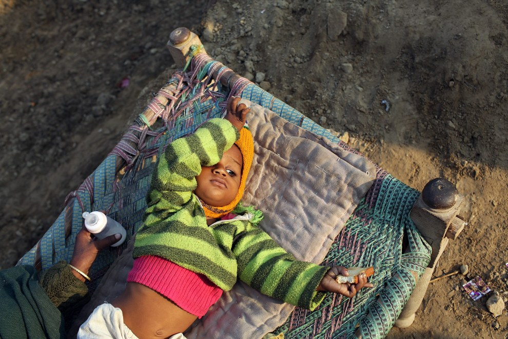 Shabhan Sheikh Siddique (1) lies on a bed outside the family home in a poor community of Kanpur. He suffers from cataracts and is one of a growing number of children in the community suffering from developmental issues believed to have been caused by increased exposure to water pollution whilst in the womb.