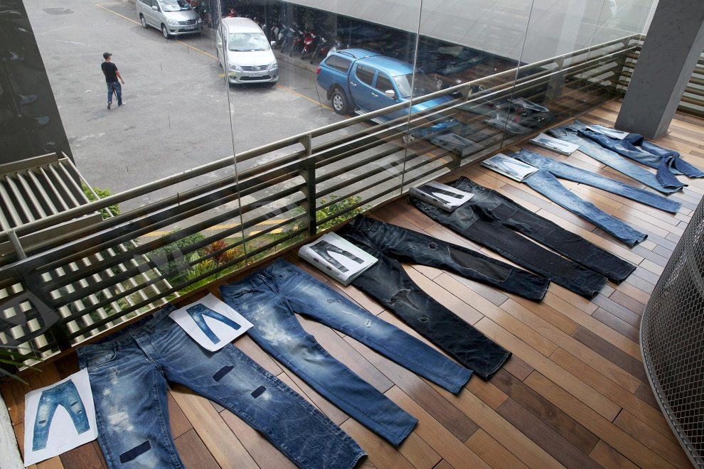 Jeans on display in a showroom at denim detailing company, Sai-Tex, located outside of Ho Chi Minh City.