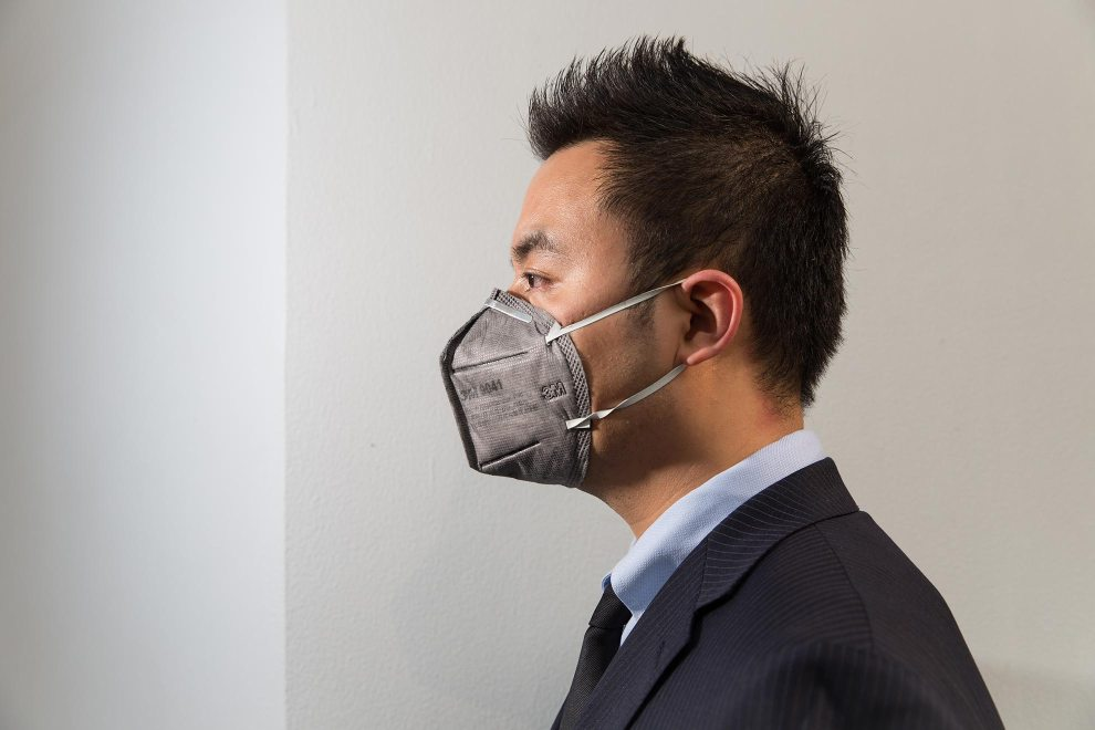 """Liu (33), a sharply-dressed office worker in central Beijing. """"I started to use the mask 3 years ago. Of course I am worried about the pollution. I bought them for everyone in my family and forced them to wear it."""" PM2.5 reading - 170 - Unhealthy"""