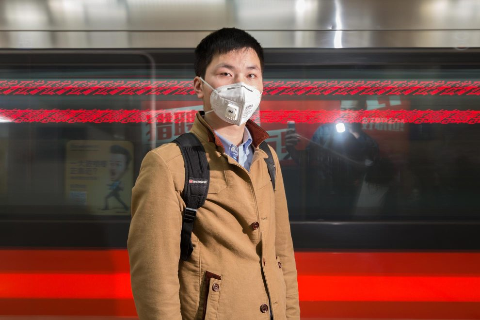 "Li (23), a sales worker from Hebei Province stands on the platform in Beijing's subway system. Many residents now not only wear the masks outdoors but also in indoor public spaces and on public transportation. ""The pollution is too much. I have worn [the mask] since 2013. My home city, Shijiazhuang, is more polluted!"" PM2.5 reading - 191 - Unhealthy"