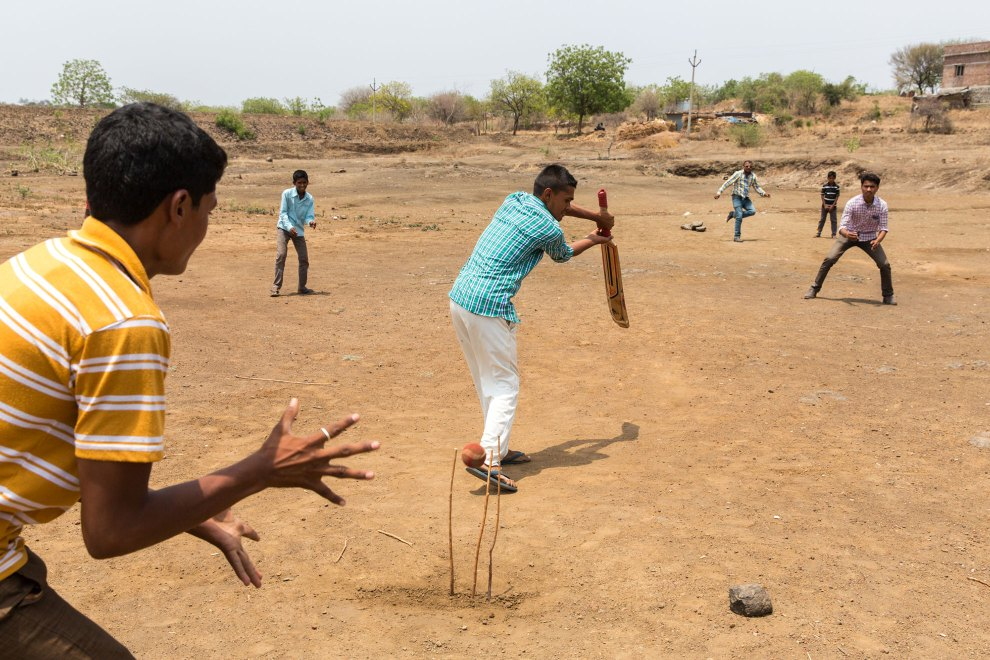 Villagers in the community of Sayyad Ankulga play cricket on the bed of a dried out lake near their village. Their's is one of thousands of villages that have been badly affected by the current drougb in Maharashtra.