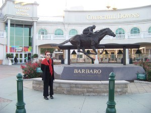 Gallagher's Travels Executive  Editor at the entrance to historic Churchill Downs.