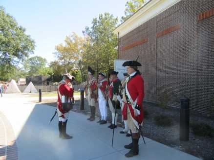 All sorts of re-enactors are located throughout the museum and grounds to demonstrate daily activities as in this particular case, weapon inspection.