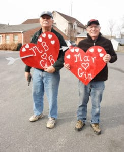 Heart Hangers. These gallant gentlemen don't wear their hearts on their sleeves but climb ladders and post the hearts on utliity poles along Talbot Street n St. Michaels.