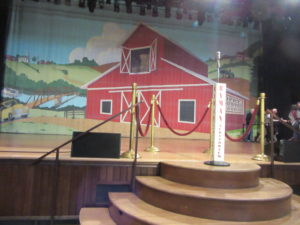 Nashville and the Ryman stage with its famous microphone stand.