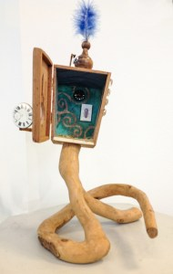 Assemblage with box and clock face
