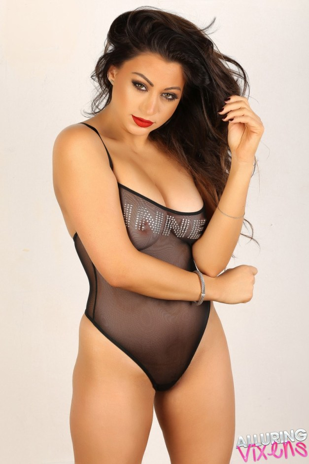 Curvy Alluring Vixens babe Jessica V teases in her almost sheer bodysuit that leaves little to the imagination