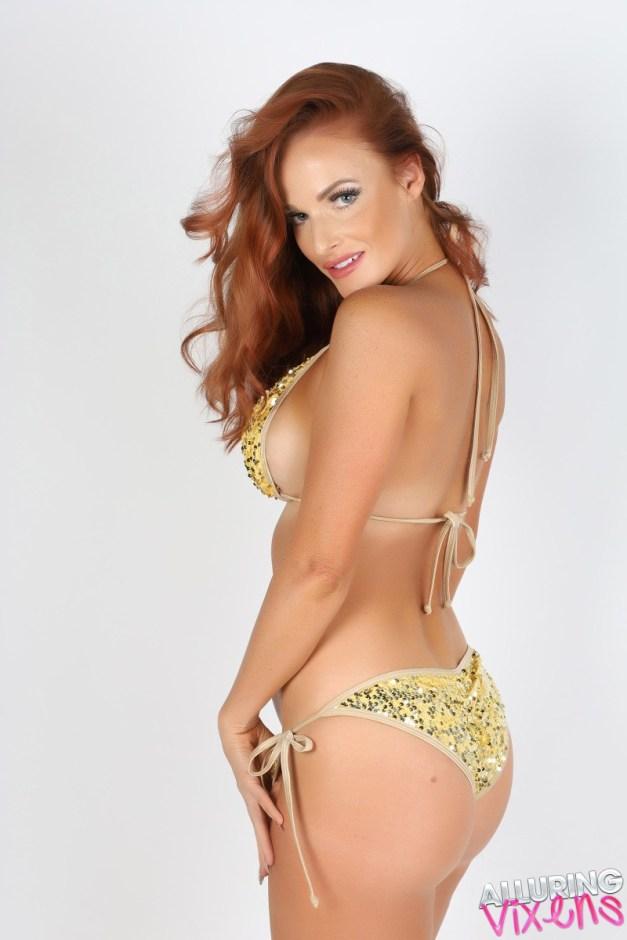 Stunning Alluring Vixen Maija teases in her gold string bikini before she gets topless