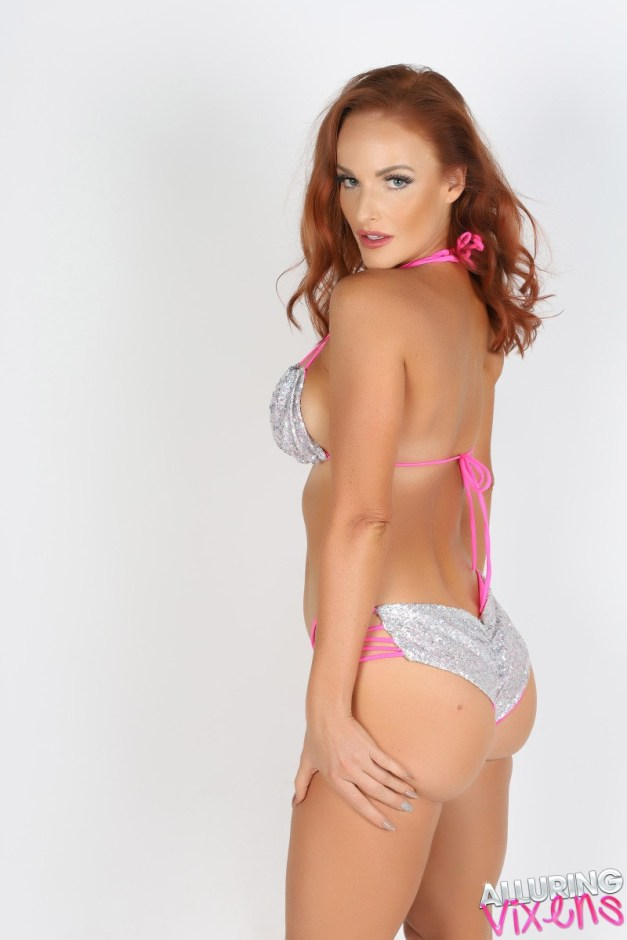 Alluring Vixen babe Maija shows off her perfect curves in her silver and pink string bikini